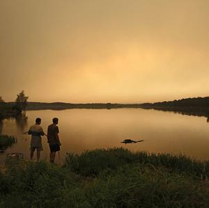 Local residents look at the smog from a peat fire in a forest near the town of Shatura, Russia