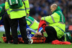 LONDON, ENGLAND - APRIL 15:  David Luiz of Chelsea is stretchered off during the FA Cup with Budweiser Semi Final match between Tottenham Hotspur and Chelsea at Wembley Stadium on April 15, 2012 in London, England.  (Photo by Clive Rose/Getty Images)