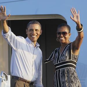 Barack Obama has returned to the US as Republican presidential candidates square off in the Iowa caucuses (AP)