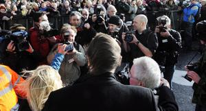 Liam Neeson is welcomed by  Ballymena Mayor PJ McAvoy and Carla Speer.