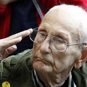 Pearl Harbor survivor David Breedlove salutes at a ceremony in New Orleans observing the 70th anniversary of the attack (AP)