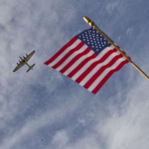 A B-17 bomber flies by a Pearl Harbor memorial service on the 70th anniversary of the attack (AP)