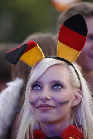 BERLIN, GERMANY - JUNE 13:  A German soccer fan smiles during the match of their team's second match during the UEFA EURO 2012 group B match between Netherlands and Germany at a public viewing zone called 'fan mile' near the Brandenburg Gate on June 13, 2012 in Berlin, Germany. Germany won 2:1 versus Netherlands.  (Photo by Andreas Rentz/Getty Images)