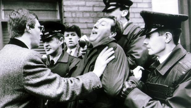 Unionist protests at visit to Belfast of Charles Haughey, former Taoiseach. Pictured are Peter Robinson, deputy leader of the DUP, intervening as Cedric Wilson is led away from the Europa. 11/4/1990.