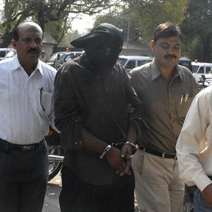 Police officials take the bus driver to court in Pune (AP)