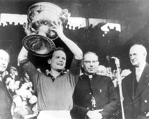 Kevin Mussen in 1960 lifts the Sam Maguire Cup as Down became the first Ulster side to win the All Ireland title