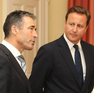 Anders Fogh Rasmussen, left, has called on European allies to spend more on defence
