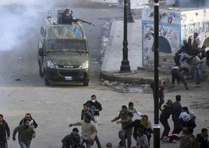 Egyptians protestors flee during clashes with anti-riot policemen in Suez, Egypt, Thursday, Jan. 27, 2011. Egyptian activists protested for a third day as social networking sites called for a mass rally in the capital Cairo after Friday prayers, keeping up the momentum of the country's largest anti-government protests in years. (AP Photo)