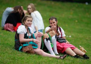 MUNICH, GERMANY - SEPTEMBER 22:  Girls dressed in Bavarian dirndl attend day 1 of Oktoberfest beer festival near Hofbraeuhaus beer tent on September 22, 2012 in Munich, Germany.This year's edition of the world's biggest beer festival Oktoberfest will run until October 7, 2012.  (Photo by Johannes Simon/Getty Images)