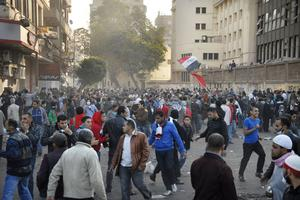 Egyptian protesters gather around Tahrir square during the clashes with the Egyptian riot police, unseen, in Tahrir square, Cairo, Egypt, Monday, Nov. 21, 2011. Egyptian riot police clashed Monday with thousands of protesters demanding that the ruling military quickly announce a date to hand over power to an elected government.  (AP Photo/Mohammed Abu Zaid)