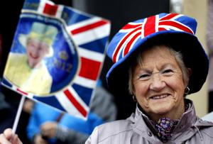 A well wisher waits for Queen Elizabeth II in Enniskillen, County Fermanagh, during a two-day visit to Northern Ireland as part of the Diamond Jubilee tour.