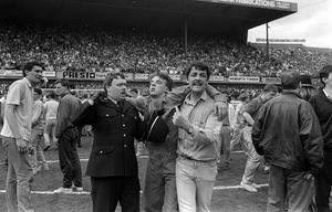An injured fan receiveing attention on the pitch