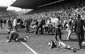 Fans recieving medical attention on the pitch