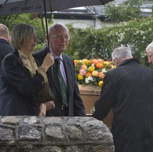 Maeve Binchy's husband Gordon Snell and her sister Joan, arrive for her funeral in Dalkey, south Dublin