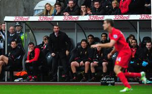 SWANSEA, WALES - NOVEMBER 25:  Liverpool manager Brendan Rodgers (c) and his bench look on during the Barclays Premier League match between Swansea City and Liverpool at Liberty Stadium on November 25, 2012 in Swansea, Wales.  (Photo by Stu Forster/Getty Images)