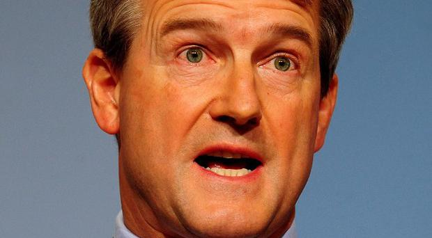 Owen Paterson's planned participation in the world's longest horse race has raised nearly 50,000 pounds for charity
