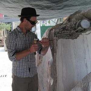 Artist Ciaran O'Brien works on a sculpture to commemorate the German bombing of Campile