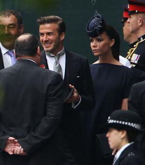 LONDON, ENGLAND - APRIL 29:  David Beckham and Victoria Beckham arrive to attend the Royal Wedding of Prince William to Catherine Middleton at Westminster Abbey on April 29, 2011 in London, England. The marriage of the second in line to the British throne is to be led by the Archbishop of Canterbury and will be attended by 1900 guests, including foreign Royal family members and heads of state. Thousands of well-wishers from around the world have also flocked to London to witness the spectacle and pageantry of the Royal Wedding.  (Photo by Dan Kitwood/Getty Images)