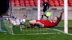 George McMullan fails to keep out Matthew Tipton's shot at Windsor Park