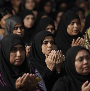 Female supporters of former president Nasheed pray during a meeting of their Maldivian Democratic Party in Male (AP)