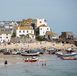 The harbour master's office in St Ives confirmed two people had reported seeing an oceanic white tip shark a mile offshore