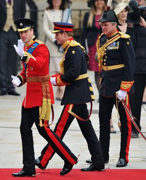 LONDON, ENGLAND - APRIL 29:  Prince William (L) waves to the crowd as he arrives with Prince Harry for the Royal Wedding of Prince William to Catherine Middleton at Westminster Abbey on April 29, 2011 in London, England. The marriage of the second in line to the British throne is to be led by the Archbishop of Canterbury and will be attended by 1900 guests, including foreign Royal family members and heads of state. Thousands of well-wishers from around the world have also flocked to London to witness the spectacle and pageantry of the Royal Wedding.  (Photo by Pascal Le Segretain/Getty Images)