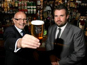 Colin Neill, chief executive of Pubs of Ulster (left) and Joel Neill, support services manager at Pubs of Ulster