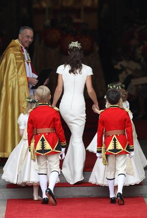 LONDON, ENGLAND - APRIL 29:  Maid of Honour Pippa Middleton with pageboys and bridemaids is greeted by The Very Reverend Dr John Hall (L), Dean of Westminster as they arrive to attend the Royal Wedding of Prince William to Catherine Middleton at Westminster Abbey on April 29, 2011 in London, England. The marriage of the second in line to the British throne is to be led by the Archbishop of Canterbury and will be attended by 1900 guests, including foreign Royal family members and heads of state. Thousands of well-wishers from around the world have also flocked to London to witness the spectacle and pageantry of the Royal Wedding.  (Photo by Chris Jackson/Getty Images)