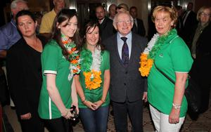 President Michael D Higgins meets Irish football fans as he arrived to meet the Irish Team at the Sheraton Hotel in Poznan, Poland