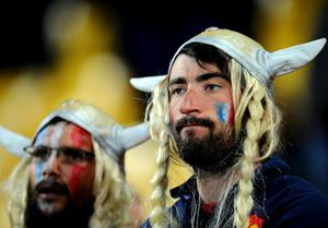 WELLINGTON, NEW ZEALAND - OCTOBER 01:  Dejected France fans look on following their team's 14-19 defeat during the IRB 2011 Rugby World Cup Pool A match between France and Tonga at Wellington Regional Stadium on October 1, 2011 in Wellington, New Zealand.  (Photo by Stu Forster/Getty Images)