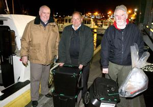 Noel McCurdy and Johnny Currie from Rathlin Island hand over The Rathlin Island Ballot boxes to  Richard Lewis Chief Executive of Moyle District Council as he brings them ashore at Ballycastle late on Thursday night, before they were were transferred to Ballymena counting centre for vertification.