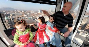One of the last families to get a ride on the Big Wheel - Paul McManus and his daughters Kaitlin (6), Erin (5) and Beth (3) from Lurgan enjoying their ride on the Big Wheel for the last time.  April 11, 2010.