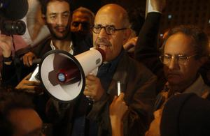 Egyptian Nobel Peace laureate and democracy advocate Mohamed ElBaradei addresses the crowd at Tahrir Square in Cairo, Sunday Jan.30, 2011. (AP Photo/Khalil Hamra)