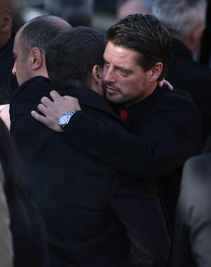 Boyzone member Keith Duffy (right) is consoled outside St Laurence O'Toole Church in Dublin after the funeral of Stephen Gately