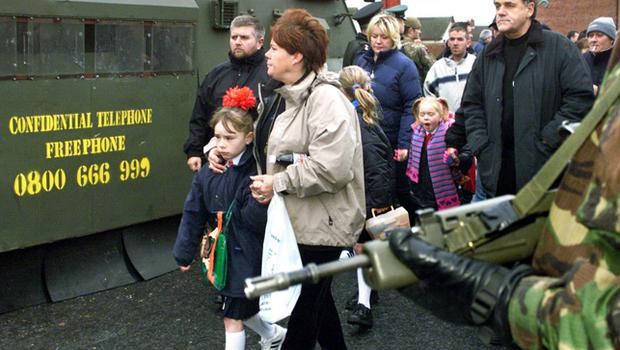 Ardoyne Road parents and their children on their way to Holy Cross Girls Primary School in what is now the tenth week of the dispute and loyalist protest.