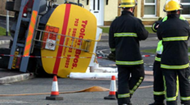 Firemen at the scene of the near disaster in Grasmere, Coleraine