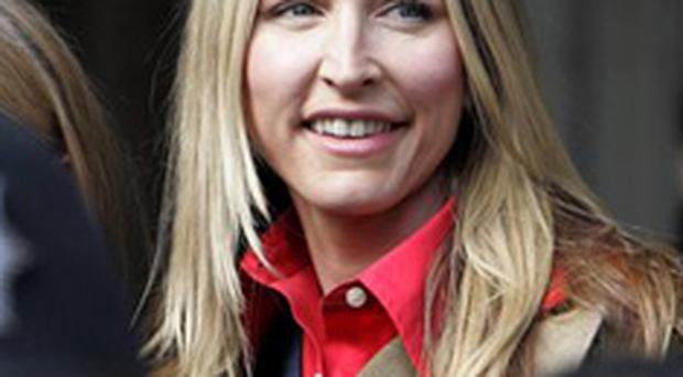 Heather Mills leaves court after securing a £24.3m divorce settlement from Sir Paul McCartney
