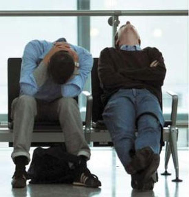 Weary travellers slumped in Terminal 5