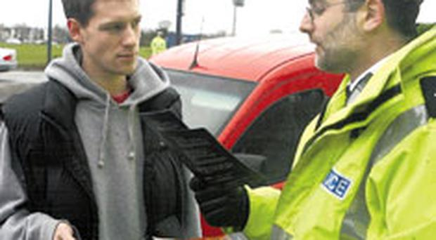 Nabbed: a police officer talks to a driver about his mobile phone