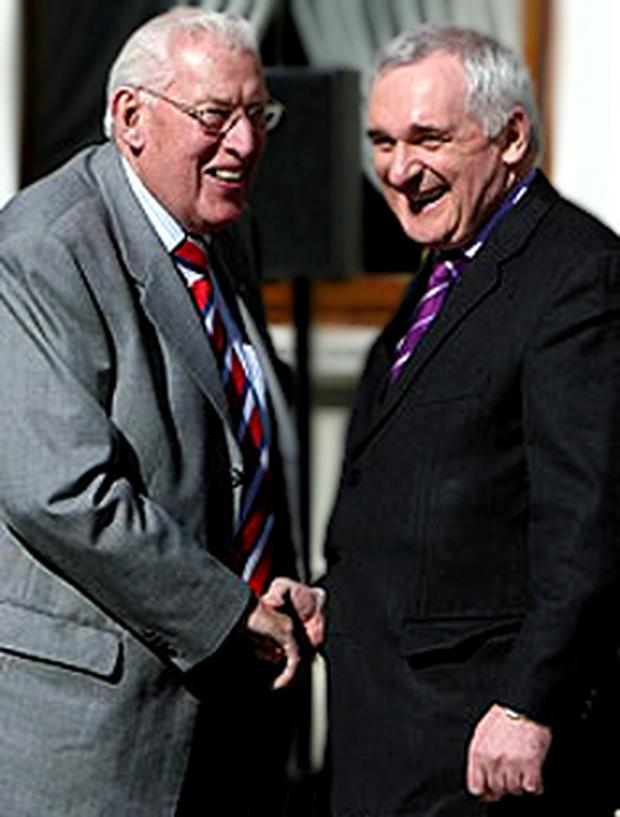 Ian Paisley and Bertie Ahern shake hands in public
