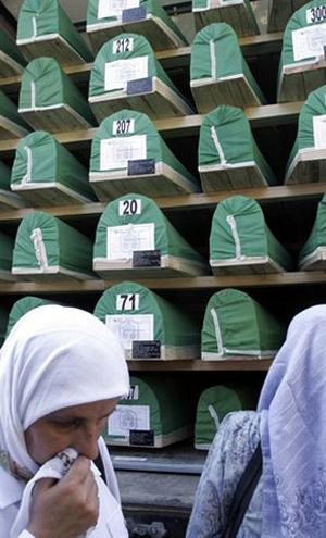 Bosnian Muslim woman cries after bidding a last goodbye to her close relative, in front of a truck with coffins of Srebrenica victims in the central Bosnian town of Visoko on the way to Srebrenica on Monday, July 9, 2007.