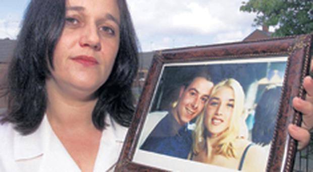 Alana Ward, mother of Eliza, with a picture of her daughter and her then fiancé Jimmy Farmer