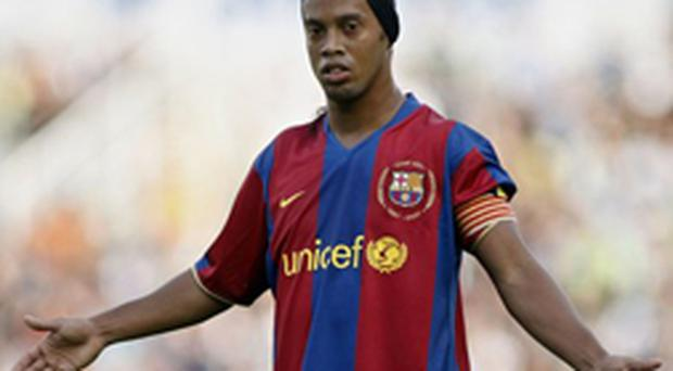 Ronaldinho gestures during Barcelona's Spanish League match against Racing Santander