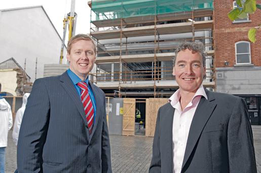 Ulster Bank's Mark Crimmins (left) is pictured discussing the £3m project with owner Jimmy Ryan on the site of the complex.