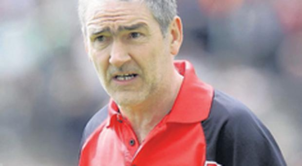 Mickey Harte has agreed a deal that will see him stay on as Tyrone manager until at least 2010