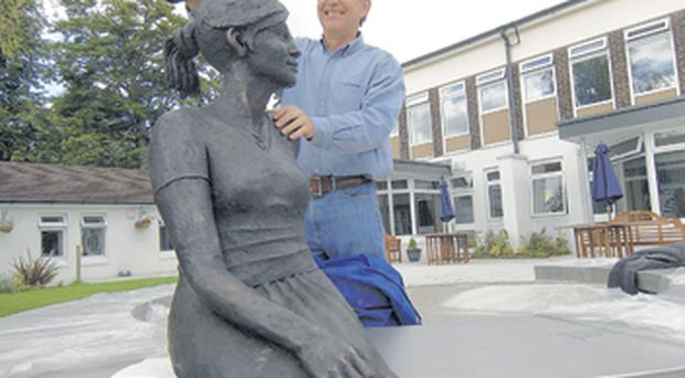 David Annand with the Listening Lady which is in the memory of Geraldine Roberts who died of cancer