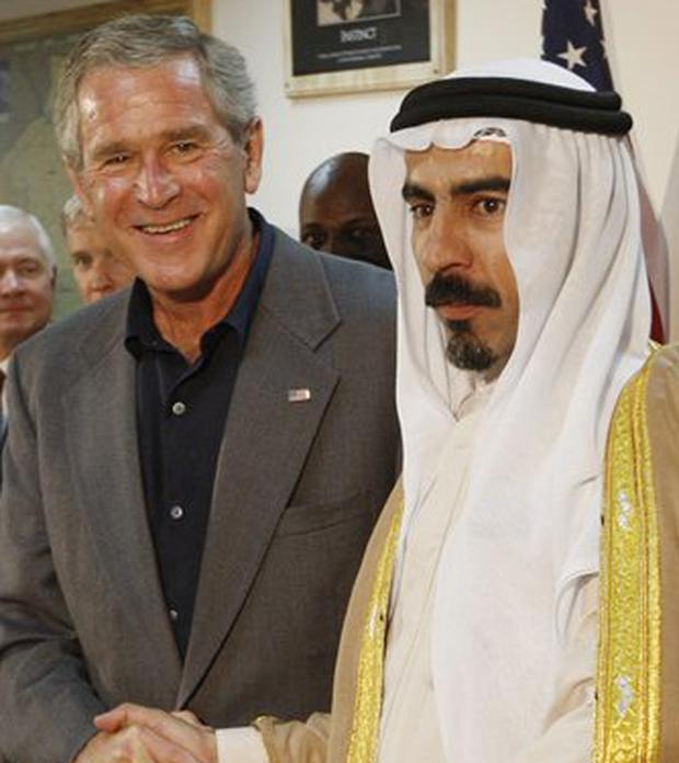 President Bush shakes hands with Abdul-Sattar Abu Risha ten days ago
