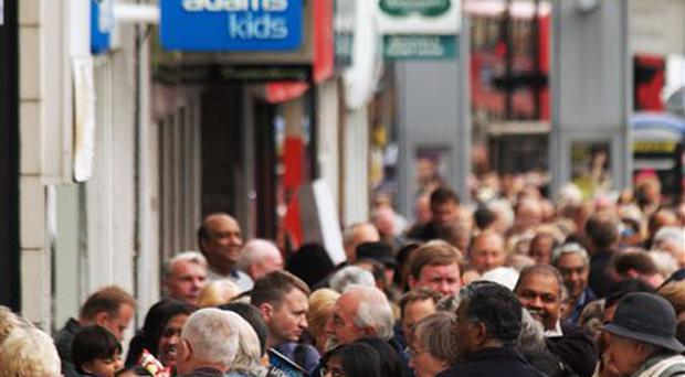 Customers queue outside a Northern Rock branch yesterday