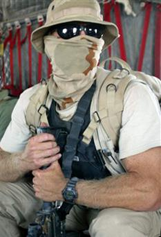 A US private security officer with his face covered