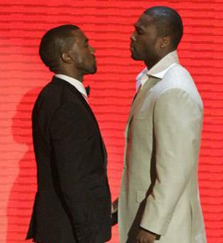 50 Cent (right) and Kayne West come face to face at the MTV Video Music Awards at the Palms Hotel and Casino last Sunday in Las Vegas